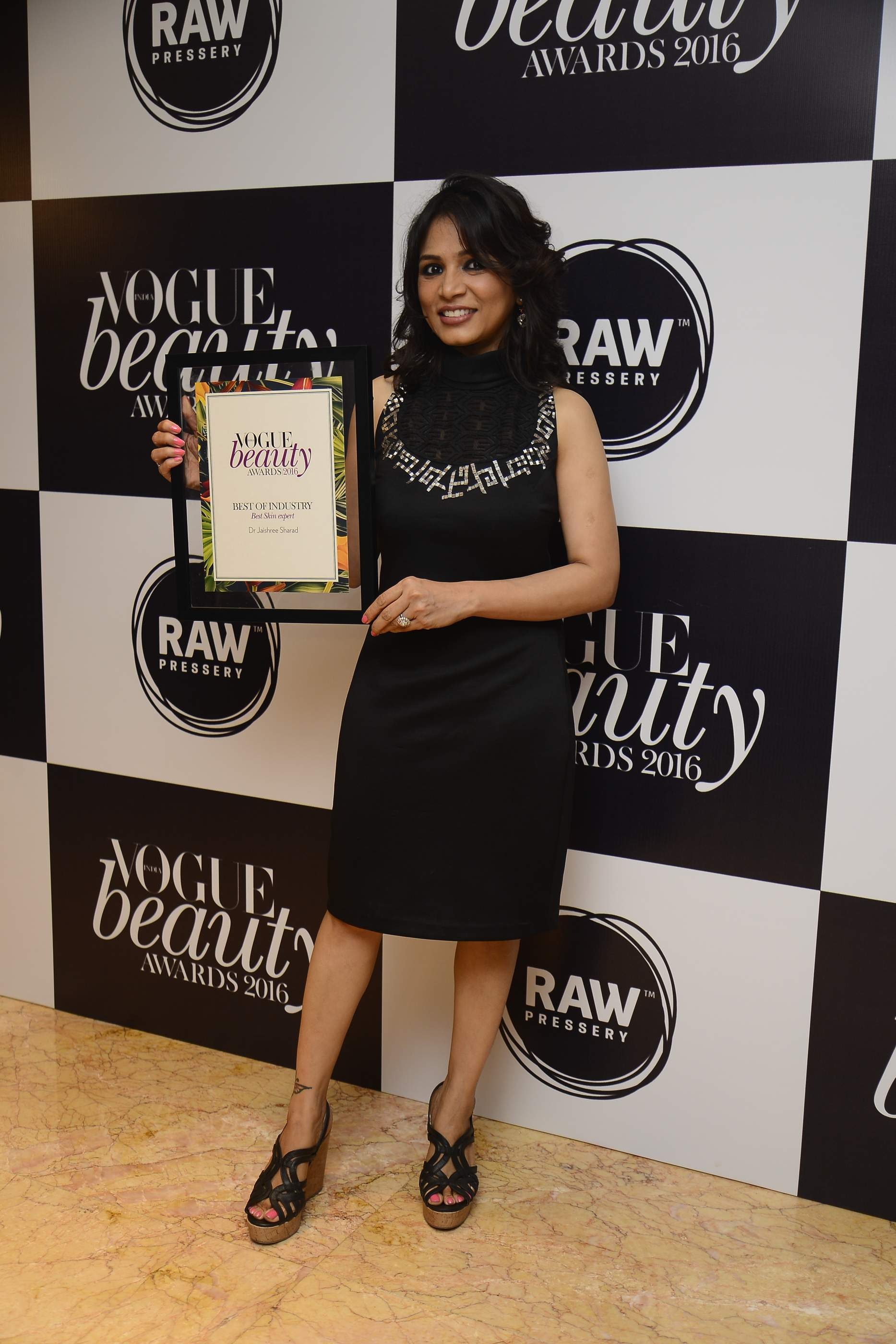 Dr. Jaishree Receiving The Best Skincare Expert Title at the Vogue Beauty Awards in 2016.