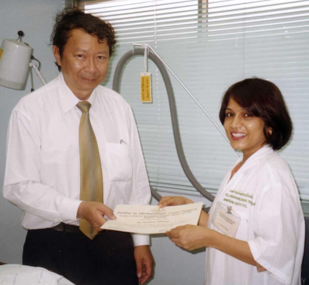 Dr. Jaishree receiving her Fellowship in Laser Surgery from Professor NiwatPolnikorn in Bangkok.