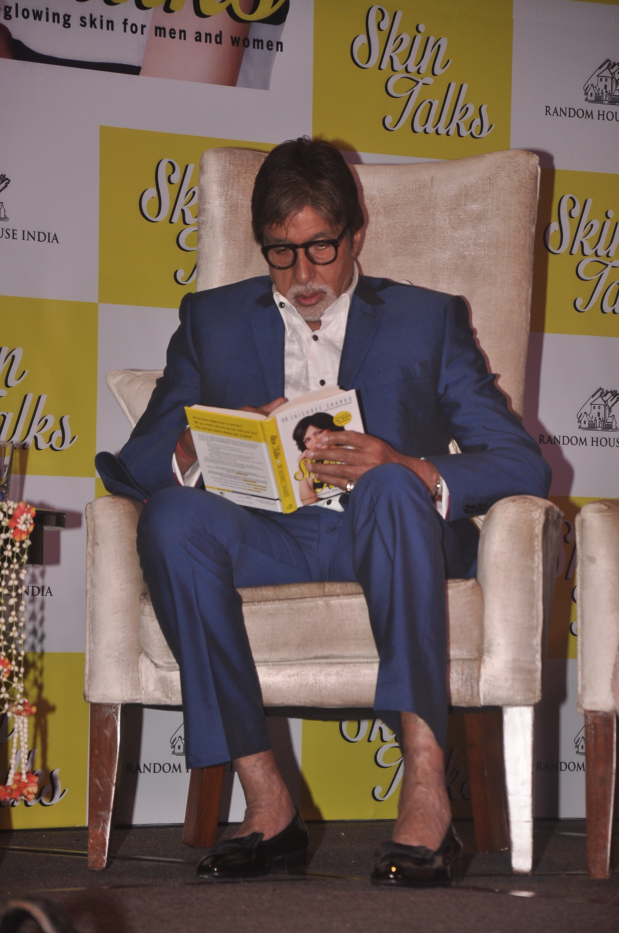 Sir AB browsing through Skin Talks during the book launch
